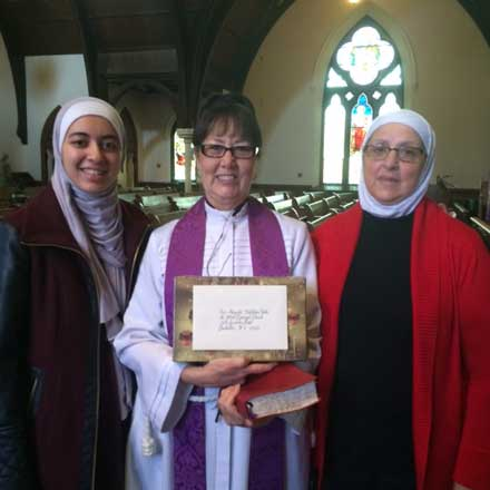 The Rev. Marquita L. Hutchens with Syrian friends of the church.